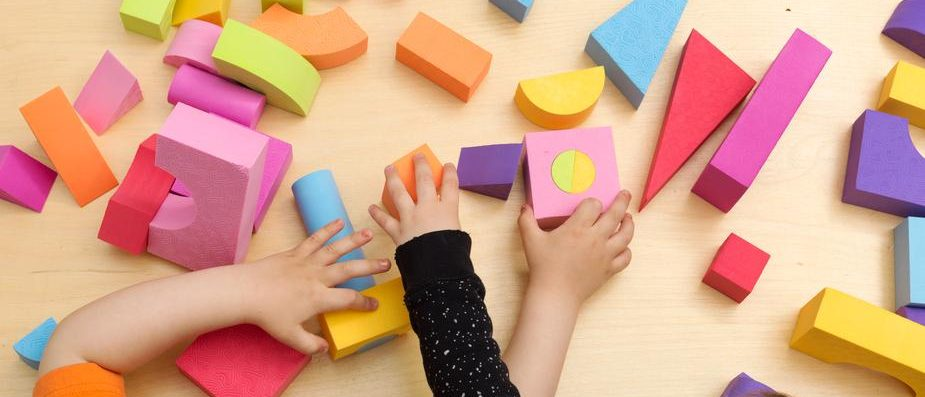 Children play with blocks at a Preschool - Childcare Centre Audit Concept